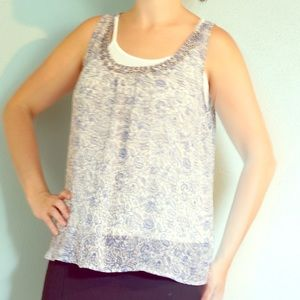 Beaded top with attached tank